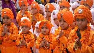 Indian Sikh school children dressed as Punj Pyara participate in a procession from the Sri Akal Takhat at the Sikh Shrine, The Golden Temple in Amritsar on October 8, 2014, on the eve of the birth anniversary of the fourth Sikh Guru Ramdass. Ramdass was born in Lahore in 1574 and is Chauthi Patshahi or the fourth Guru as well as the Guru who established the city of Amritsar. AFP PHOTO /NARINDER NANU (Photo credit should read NARINDER NANU/AFP/Getty Images)