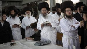 Ultra-Orthodox Jews wear white holiday cloths during noon prayers a few hours before the start of Yom Kippur, the Jewish holy day of Atonement, on September 17, 2010 at a synagogue in the central Israeli town of Bet Shemesh. Shops were to shut down and all motorized traffic come to a complete halt until the evening of 18 September to observe the Day of Atonement --a period of fasting, reflection and prayers on the holy day in the Jewish calendar. AFP PHOTO/MENAHEM KAHANA (Photo credit should read MENAHEM KAHANA/AFP/Getty Images)