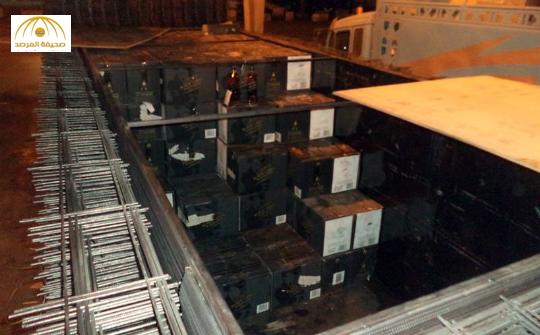 بالصور : شاهد أحدث الطرق لتهريب 13650 زجاجة من الخمور بجمرك البطحاء