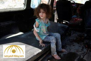 ATTENTION EDITORS - VISUAL COVERAGE OF SCENES OF INJURY OR DEATHAn injured girl sits in a vehicle after surviving double airstrikes on the rebel held Bab al-Nairab neighborhood of Aleppo, Syria, August 27, 2016. REUTERS/Abdalrhman Ismail