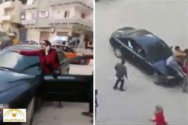 بالفيديو : فتاة مصرية تدهس شبان خلال مشاجرة مسلحة!