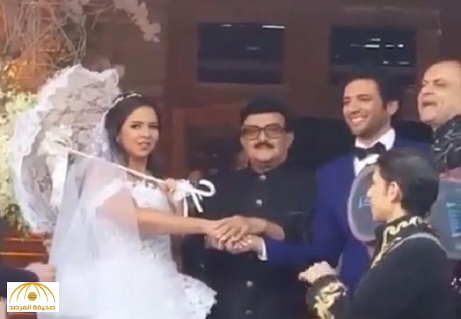 بالفيديو.. شاهدوا كيف كسرت ايمي سمير غانم التقاليد في حفل زفافها من حسن الرداد