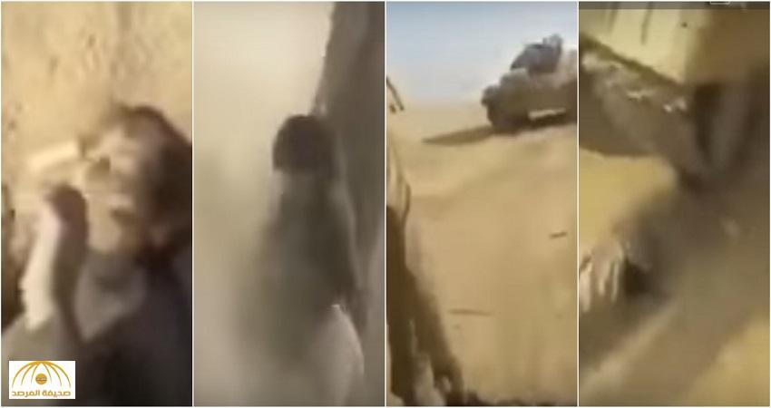 """شاهد: جنود الحشد الشعبي يقتلون طفلاً عراقيًا.. و""""دبابة"""" تسوي جثته بالأرض"""