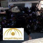 بالصور: داعش يلقي بشاب من مبنى مرتفع في ريف حلب ويرجمه بالحجارة