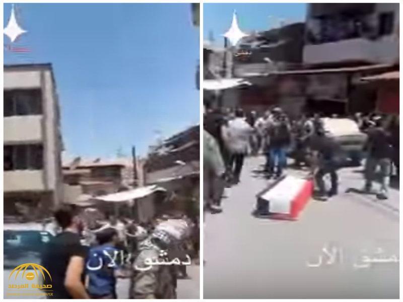 شاهد..قتلى وسقوط النعش أثناء تشييع أحد عناصر الأسد في دمشق