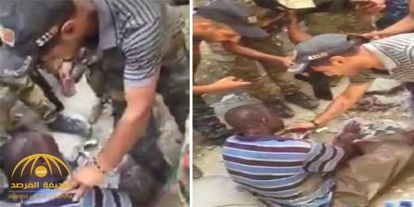 """شاهد بالفيديو.. تحقيق وحشي مع """"سوداني"""" في البصرة !"""