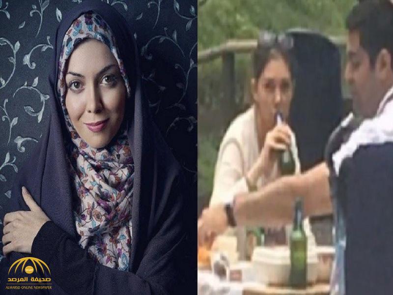 """شاهد: مذيعة إيرانية ترتدي الحجاب في بلدها  وتخلعه خارجه وتحتسي """" الخمر"""" !-فيديو"""