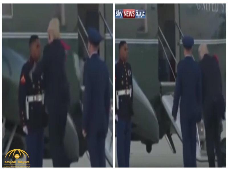 """بالفيديو: شاهد ماذا فعل الهواء الشديد  بـ""""ترامب"""" و""""قبعة الجندي""""!"""