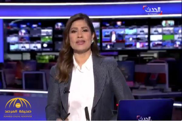 شاهد.. عامل يخرج فجأة خلف مذيعة  قناة  العربية على الهواء