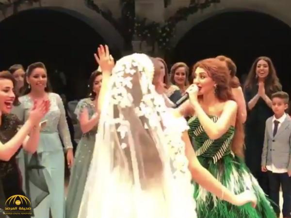 """بالفيديو :  """"ميريام فارس"""" تؤدي رقصة مثيرة في حفل زفاف.. شاهد ردة فعل العروس!"""