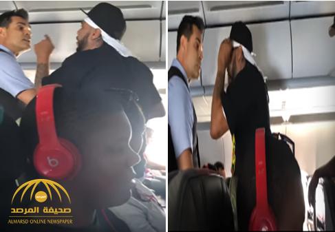 شاهد: ماذا فعل مسافر أمريكي داخل طائرة ركاب ليواجه عقوبة السجن 20 عامًا.. وضابط شرطة يبلغ السلطات بهذه المعلومة الهامة عنه!