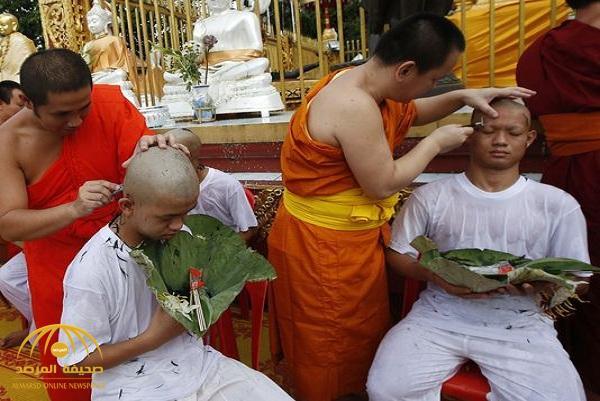 شاهد: لحظات ترسيم فتية كهف تايلاند رهبانًا بوذيين!