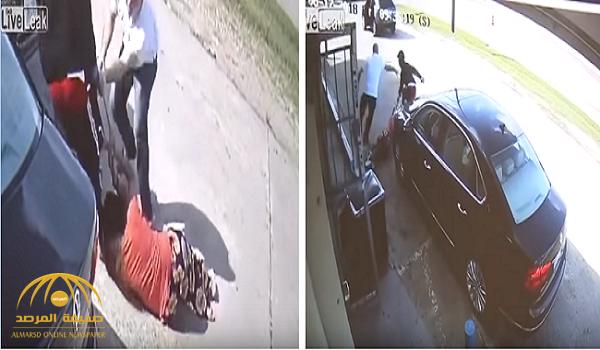 """شاهد.. لحظة سرقة 75 ألف دولار من امرأة في أمريكا.. ومعركة عنيفة مع زوجها تنتهي بـ""""قفزة في السيارة"""""""