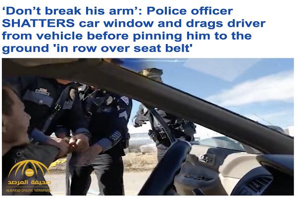 شاهد.. ضابط  أمريكي يحطم نافذة سيارة بقوة في ولاية نيو مكسيكو .. وهذا ما فعله مع قائدها