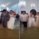 """بالفيديو: عروس تتحدى الطبيعة وتعقد قرانها بأجواء """"مستحيلة""""!"""