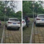 شاهد ما فعله صيني غاضب بسيارة مركونة بشكل خاطئ