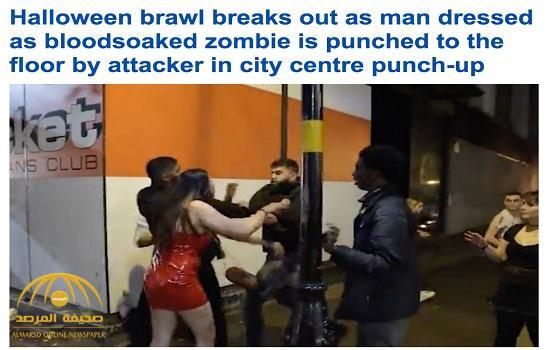 """شاهد .. مشاجرة عنيفة بين محتفلين بعيد """"الهالويين"""" في بريطانيا.. وهكذا حاولت  فتاة التدخل بينهم!"""