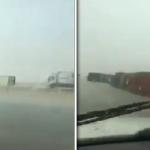 شاهد .. انقلاب عدة شاحنات على طريق الرياض – الدمام.. وموثق الفيديو يكشف السبب!