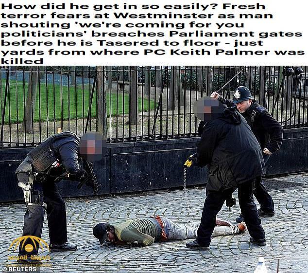 """ترجمة حصرية .. شاهد: الشرطة البريطانية تصعق رجل أفريقي اقتحم البرلمان وصاح """"قادمون لكم""""!"""