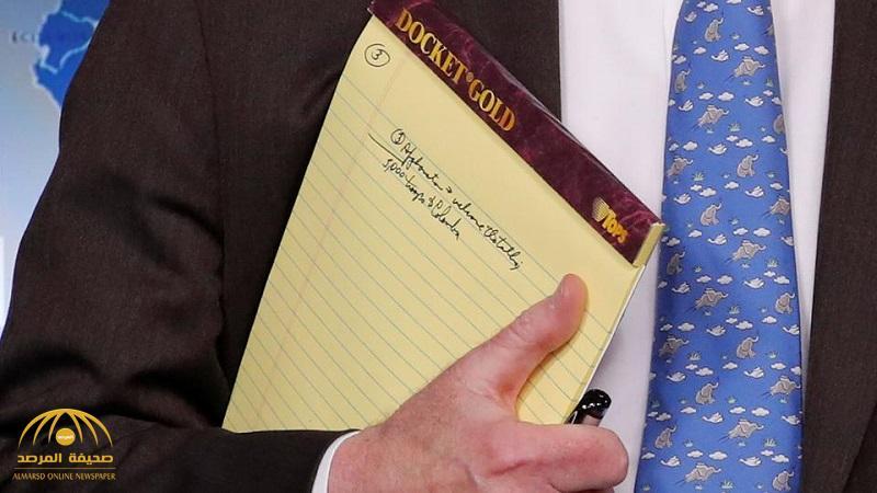 """مصورون يوثقون ملاحظة على دفتر """"بولتون"""" تفضح خطة ترامب في فنزويلا !"""