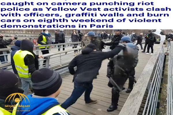 شاهد : متظاهر يهاجم الشرطة الفرنسية ويوجه لهم وابل من اللكمات .. ومفاجأة بعد الكشف عن هويته !