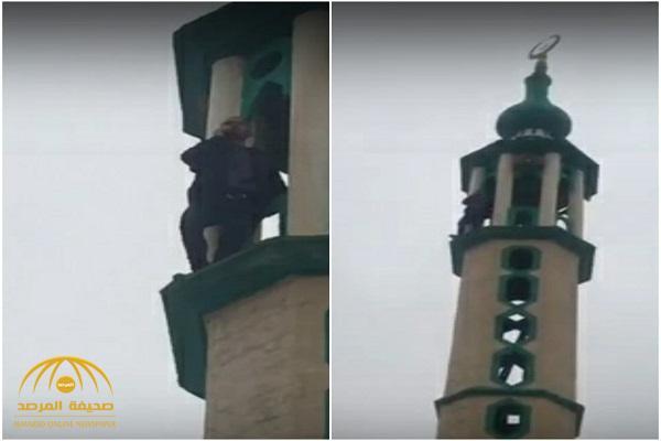 شاهد: شاب يحاول الانتحار من فوق مئذنة مسجد بالأردن