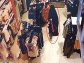 شاهد : منتقبة تحاول خطف طفلة داخل محل ملابس
