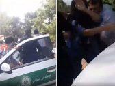 """انكشف جسمها.. شاهد: سحل فتاة إيرانية غير محجبة واعتقالها من الشرطة بسبب """"مسدس لعبة"""""""