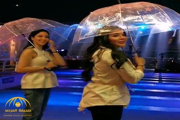 بالفيديو.. لجين عمران وشقيقتها أسيل تحت شلال بكوريا