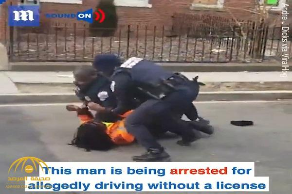 """شاهد: كيف تعاملت الشرطة الأمريكية مع سائق """" أسمر"""" رفض رفع يديه في واشنطن"""