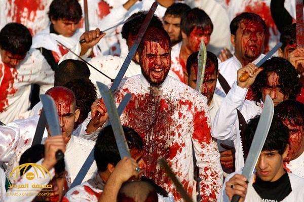 شاهد بالصور والفيديو : مئات من الشيعة  في العراق يضربون أجسادهم بالسكاكين والسيوف بسب مقتل الحسين قبل أكثر من 1300 عام !
