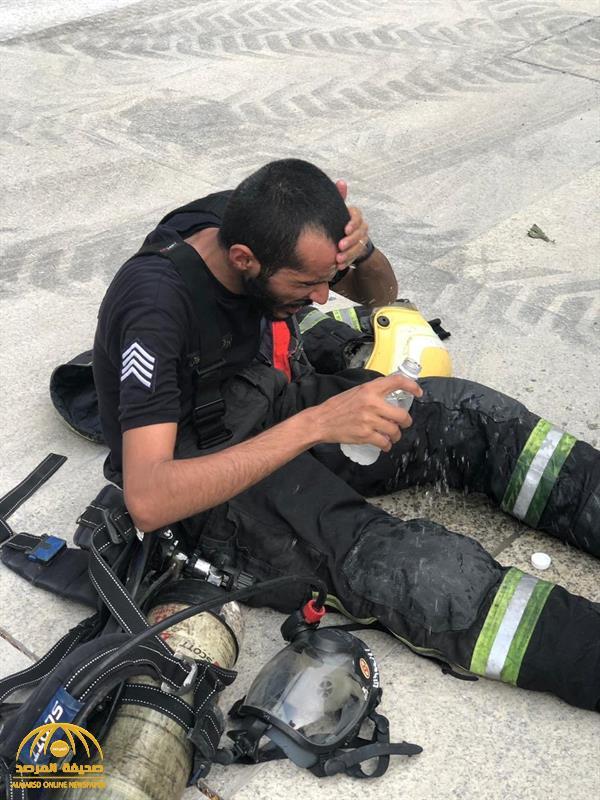 بالصور … شاهد كيف بدا رجال الدفاع المدني بعد 12 ساعة مروعة للسيطرة على الحريق بمحطة قطار الحرمين !