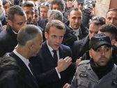 """شاهد : الرئيس الفرنسي يوبخ ويطرد شرطيًا إسرائيليًا داخل كنيسة في القدس : """"لم يعجبني ما قمت به.. أخرج""""!"""