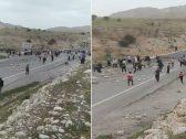شاهد : إيرانيون يغلقون الطرق ويقذفون القادمين من المحافظات الأخرى بالحجارة خوفاً من كورونا