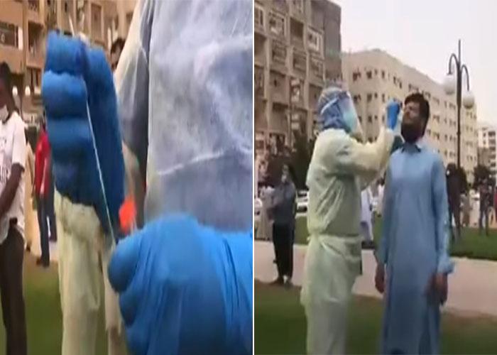 """شاهد: لحظة إجراء المسح النشط على عمالة وافدة في الرياض.. والفريق الطبي يلجأ لطريقة فعالة لسرعة رصد """"كورونا"""" !"""