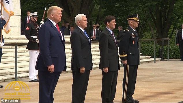 """شاهد:  اهتزاز"""" ترامب""""  أثناء وقوفه في مراسم ذكرى قتلى الحروب السنوي بأمريكا تثير الشكوك حول حالته الصحية"""