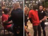 شاهد: رجال شرطة أمريكيون يقيدون رجل أسود بعد القبض عليه .. وبعد إظهار هويته كانت المفاجأة!