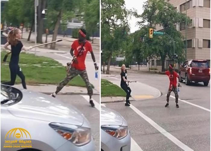 """شاهد : امرأة بيضاء تعتدي على رجل أسود وصديقته بـ """"مضرب الهوكي""""!"""
