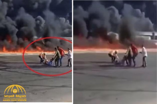 """شاهد: لحظة إنقاذ """"مصري"""" قبل أن تلتهمه النيران ونجاته من موت محقق"""