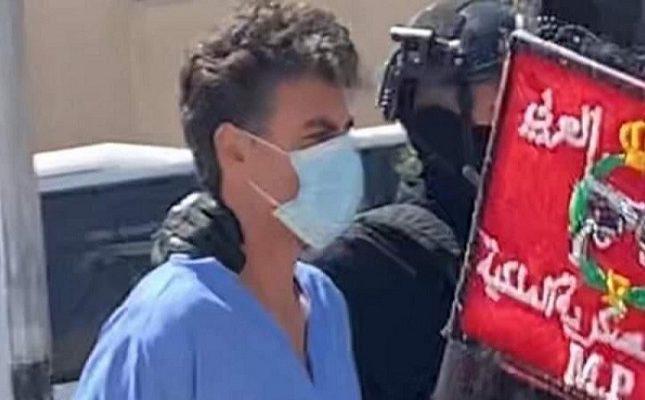 """بعد باسم عوض.. شاهد أول صورة للمتهم الثاني في الأردن """"الشريف حسن"""" بالبدلة الزرقاء"""
